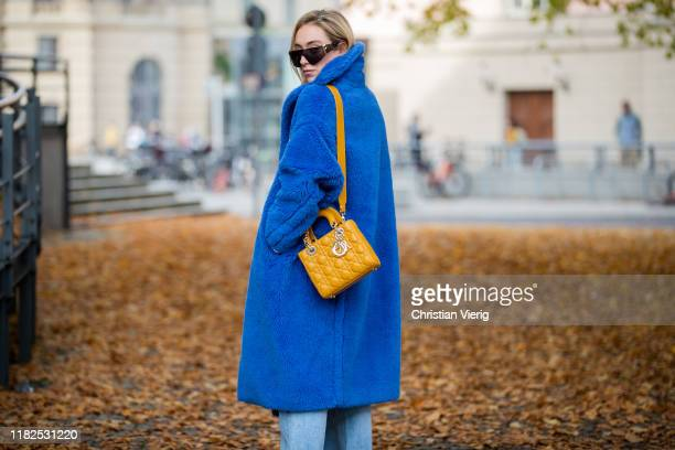 Sonia Lyson is seen wearing Agolde jeans, blue Max Mara teddy coat, Lady Dior bag, Fendi sunglasses on October 21, 2019 in Berlin, Germany.