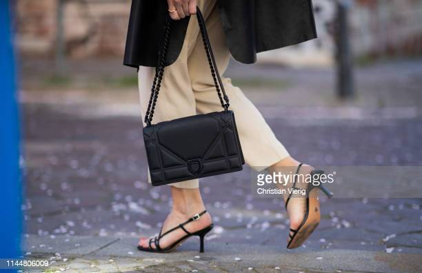 Sonia Lyson is seen wearing beige Massimo Dutti pants Zara sandals Uterque leather cape black Dior bag on April 23 2019 in Berlin Germany
