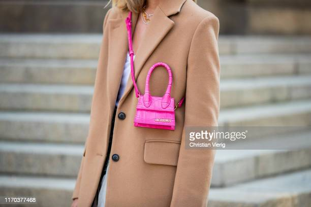 Sonia Lyson is seen wearing beige oversized blazer Other Stories pink mini Jacquemus bag on August 26 2019 in Berlin Germany