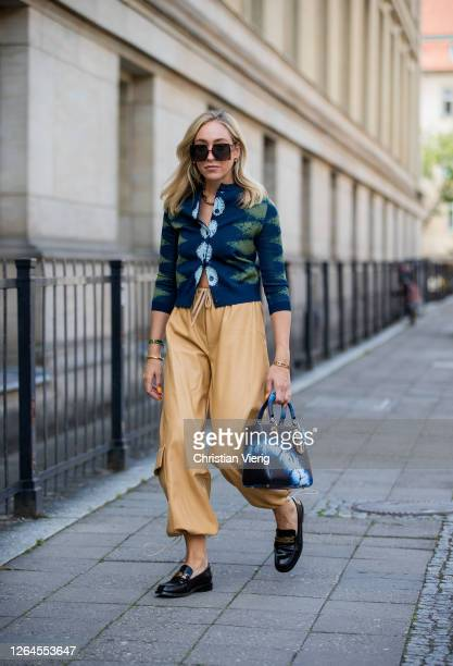Sonia Lyson is seen wearing beige pants The Frankie shop, cardigan Dior, Dior bag, loafers Dior, sunglasses Dior August 07, 2020 in Berlin, Germany.