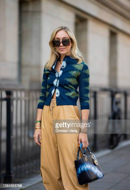 Sonia Lyson is seen wearing beige pants The Frankie shop cardigan Dior Dior bag sunglasses Dior August 07 2020 in Berlin Germany