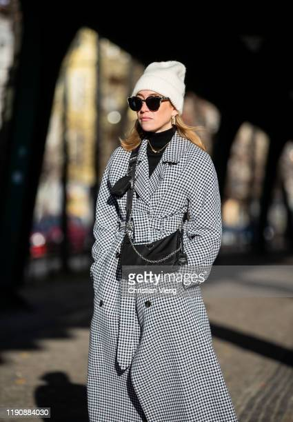 Sonia Lyson is seen wearing black boots Jeffrey Campbell beige military pants Gina Tricot Prada bag black white coat Closed black turtleneck Zara...