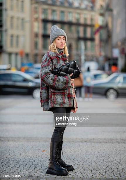 Sonia Lyson is seen wearing black laced boots Zara pants Zara cashmere turtleneck Bottega Veneta bag grey red plaid jacket Lala Berlin grey beanie...