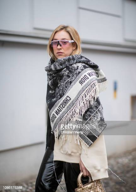 Sonia Lyson is seen wearing black leather pants and two tone sweater Topshop, Dior bag, poncho Dior, Oaykley sunglasses, olivie Dior boots during the...