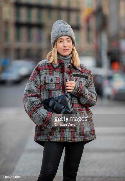 Sonia Lyson is seen wearing black pants Zara cashmere turtleneck Bottega Veneta bag grey red plaid jacket Lala Berlin grey beanie Acne on October 29...