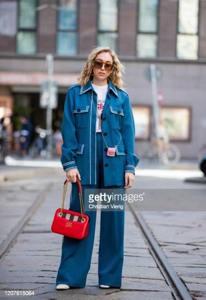 Sonia Lyson is seen wearing blue jacket and wide leg pants Fendi white tshirt red bag and pink micro bag Fendi during Milan Fashion Week Fall/Winter...