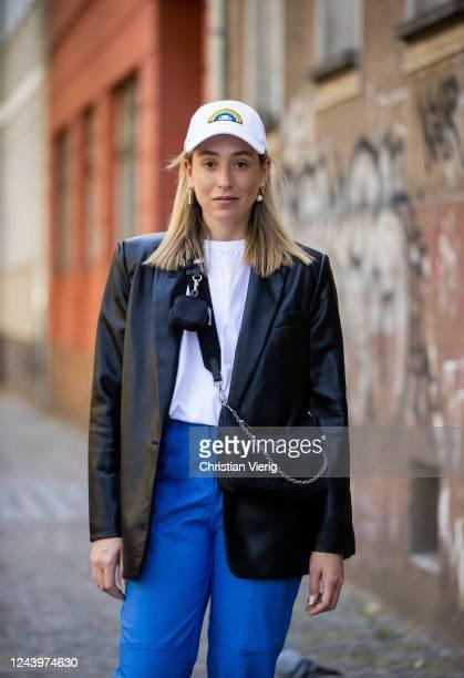 Sonia Lyson is seen wearing blue Milkwhite pants white The Frankie Shop tshirt Prada bag cap Lacoste black Zara blazer on June 03 2020 in Berlin...