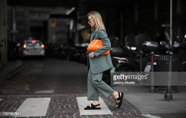 Sonia Lyson is seen wearing Bottega Veneta orange pouch, Chanel shoes during Milan Fashion Week Fall/Winter 2020-2021 on February 20, 2020 in Milan,...
