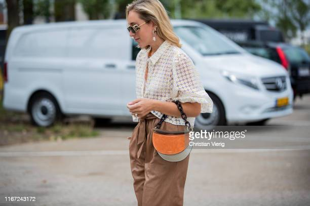 Sonia Lyson is seen wearing brown pants, button shirt, bag outside Munthe during Copenhagen Fashion Week Spring/Summer 2020 on August 07, 2019 in...