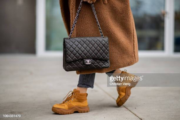 Sonia Lyson is seen wearing brown Zara wild leather winter boots dark grey cropped Levis denim jeans neon turtleneck Zara brown Max Mara teddy coat...