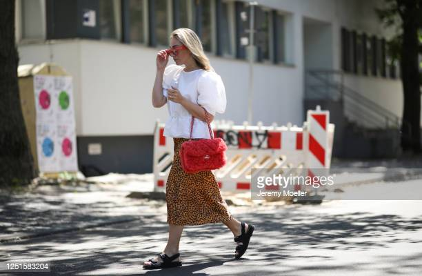 Sonia Lyson is seen wearing Chanel sandals, bag and fine jewelry, Topshop skirt and blouse and Celine sunglasses on June 23, 2020 in Berlin, Germany.
