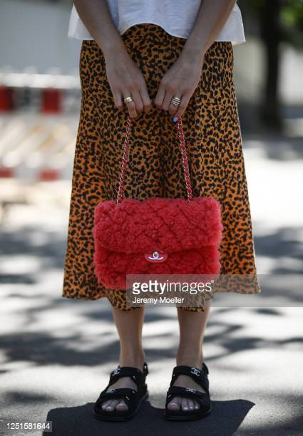 Sonia Lyson is seen wearing Chanel sandals, bag and fine jewelry, Topshop skirt on June 23, 2020 in Berlin, Germany.