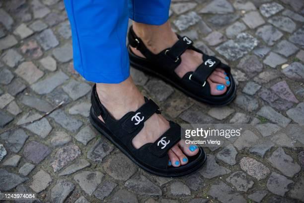 Sonia Lyson is seen wearing Chanel sandals, blue Milkwhite pants on June 03, 2020 in Berlin, Germany.