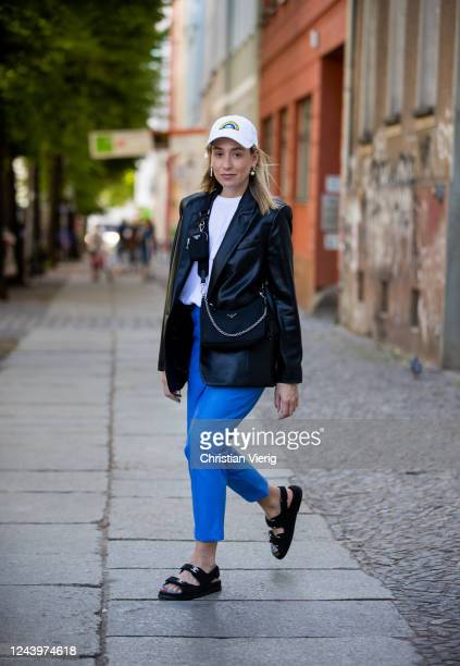 Sonia Lyson is seen wearing Chanel sandals blue Milkwhite pants white The Frankie Shop tshirt Prada bag cap Lacoste black Zara blazer on June 03 2020...