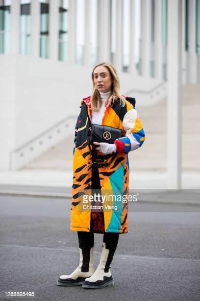 Sonia Lyson is seen wearing creme white two tone Bottega Veneta Tire boots, Desigual coat, Louis Vuitton Pont Neuf bag, Zara jogger pants, Lala...