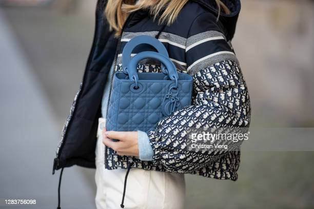 Sonia Lyson is seen wearing Dior bag in blue, Dior jacket with logo print, creme white pants Closed, Zara turtleneck on November 03, 2020 in Berlin,...