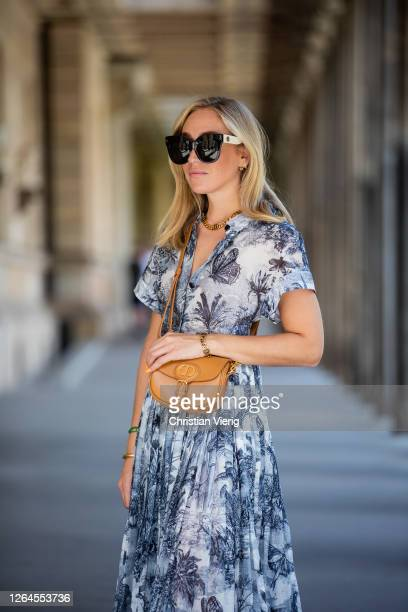 Sonia Lyson is seen wearing Dior dress with print brown bag Dior net socks Dior loafers Linda Farrow sunglasses on August 07 2020 in Berlin Germany