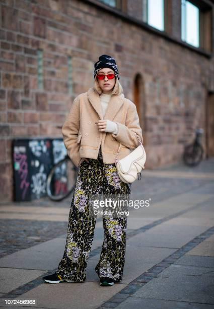 e8f7891114d Sonia Lyson is seen wearing Dior saddle bag Balenciaga beanie beige cropped  jacket Samsoe Samsoe and