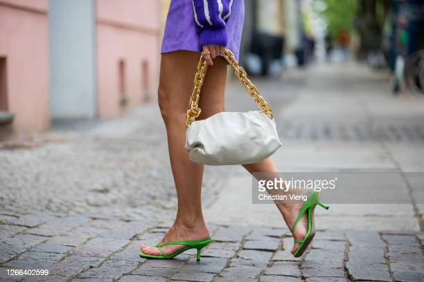 Sonia Lyson is seen wearing Ducie shoes, purple skirt and knit Edited, sunglasses and bag Bottega Veneta on August 14, 2020 in Berlin, Germany.