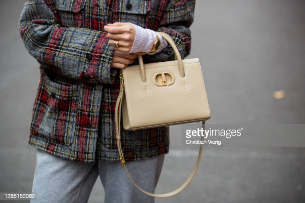 Sonia Lyson is seen wearing grey jogger pants Topshop, checkered jacket Lala Berlin, beige Dior bag St Honore, watch Kapten & Son on November 11,...