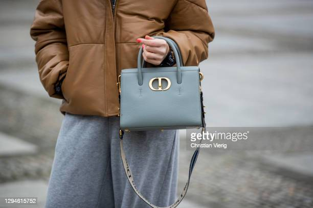 Sonia Lyson is seen wearing grey jogger pants Zara, brown Ducie London jacket, Dior bag on January 05, 2021 in Berlin, Germany.