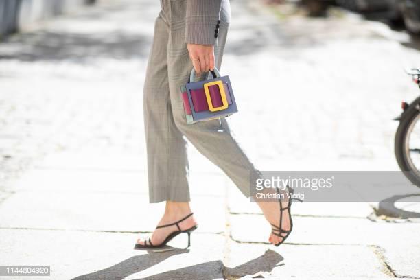 Sonia Lyson is seen wearing grey Max Mara suit Zara sandals Boyy x Luisa Via Roma bag on April 23 2019 in Berlin Germany