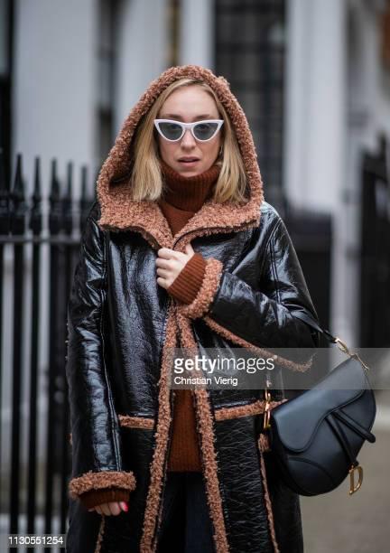 Sonia Lyson is seen wearing Levis jeans rust colored Zara turtleneck knit black Dior saddle bag Vogue eyewear x Gigi Hadid Munthe shearling coat...