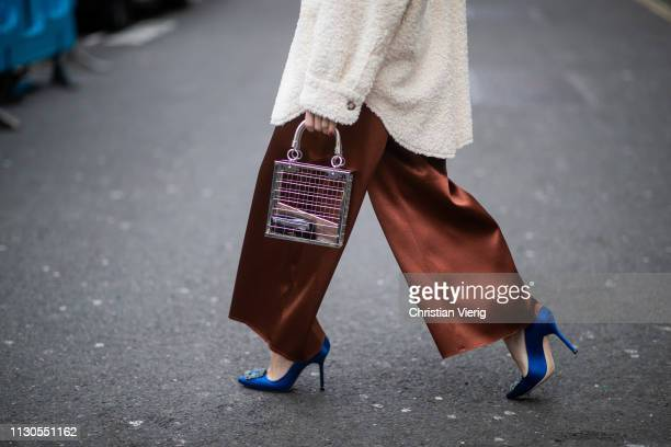 Sonia Lyson is seen wearing Manolo Blahnik heels, wide leg pants, shearling shirt Topshop, see through bag Topshop during London Fashion Week...