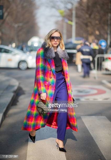 Sonia Lyson is seen wearing multi color plaid coat outside Armani on Day 2 Milan Fashion Week Autumn/Winter 2019/20 on February 21 2019 in Milan Italy