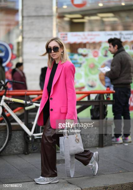 Sonia Lyson is seen wearing New Balance sneaker, a rosa blazer and a Dior Lady bag during Milan Fashion Week Fall/Winter 2020-2021 on February 20,...