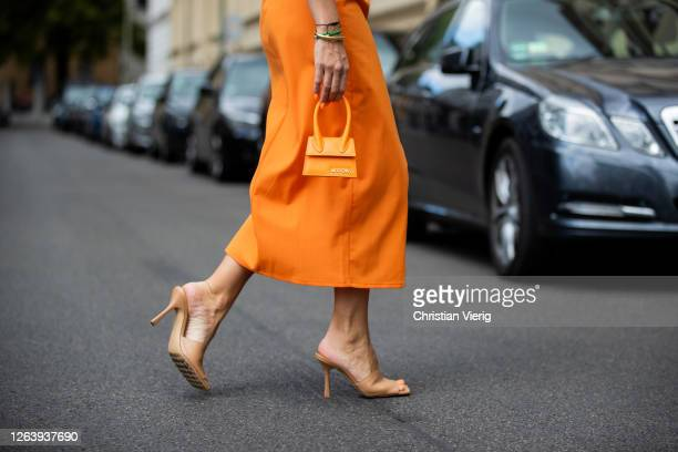 Sonia Lyson is seen wearing orange dress Zara Jacquemus mini bag shoes Bottega Veneta on August 04 2020 in Berlin Germany
