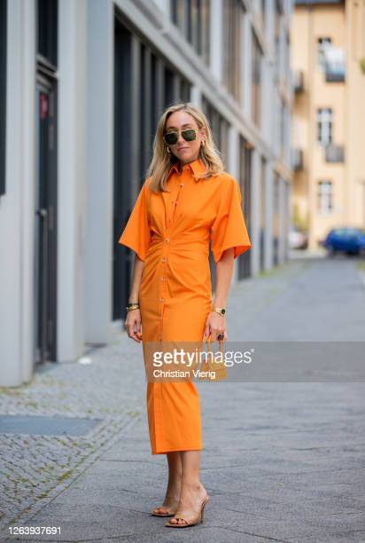Sonia Lyson is seen wearing orange dress Zara Jacquemus mini bag shoes Bottega Veneta sunglasses Bottega Veneta on August 04 2020 in Berlin Germany