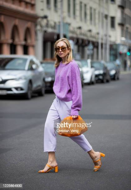 Sonia Lyson is seen wearing orange sandals By Far x Luisa Via Roma LVR grey jogger pants Lala Berlin purple knit Other Stories orange bag Bottega...