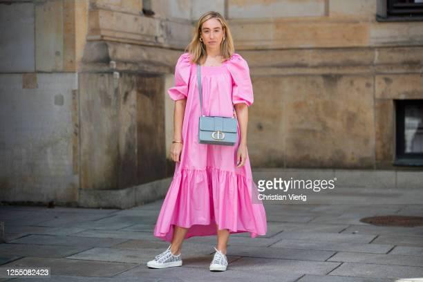 Sonia Lyson is seen wearing pink dress H&M, sneaker Dior, bag Dior on July 08, 2020 in Berlin, Germany.