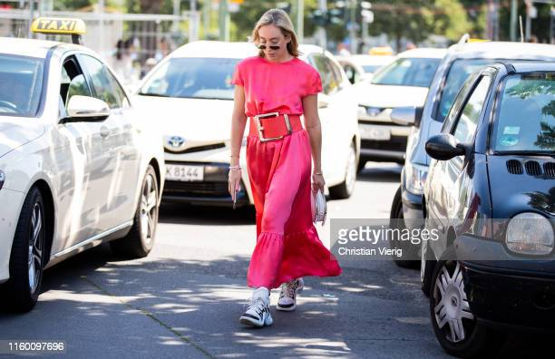 Sonia Lyson is seen wearing pink dress white Prada bag Louis Vuitton sneaker outside Marina Hoermanseder during Berlin Fashion Week on July 04 2019...