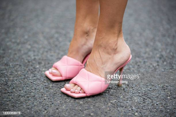 Sonia Lyson is seen wearing pink mules Bottega Veneta, white ripped bermuda shorts Pull & Bear, pink tshirt Jacquemus, yellow Lumina blazer, yellow...