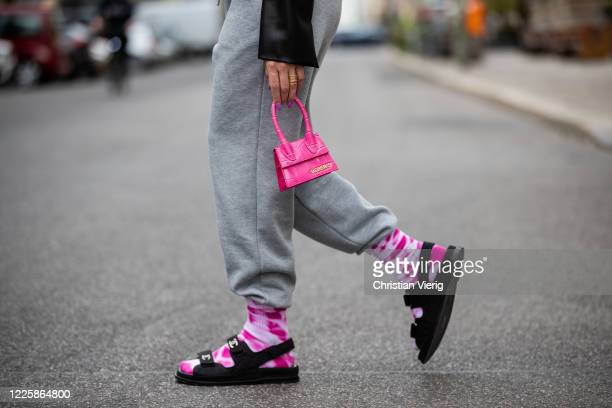 Sonia Lyson is seen wearing pink white socks Weekday, sandals Chanel, grey jogger pants Topshop, pink mini bag Jacquemus on May 19, 2020 in Berlin,...