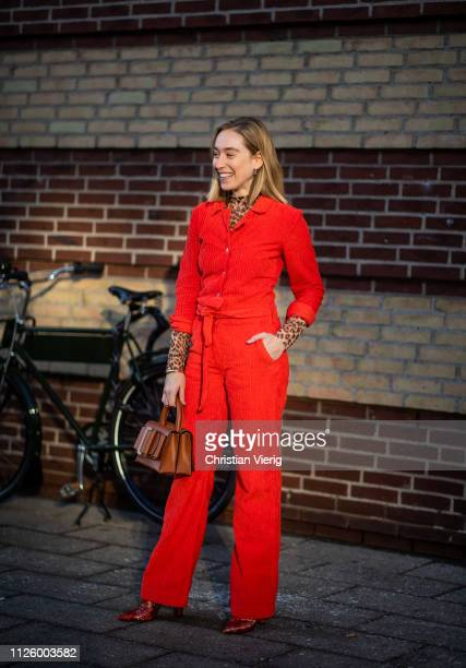Sonia Lyson is seen wearing red top and pants brown Boyy bag turtleneck with animal print outside Blanche during the Copenhagen Fashion Week...