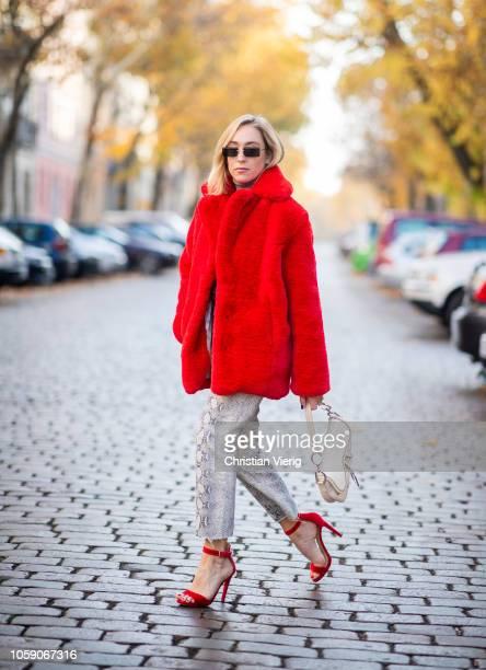 Sonia Lyson is seen wearing red velvet sandals Mai Piu senza cropped snake print jeans turtleneck Zara red Ducie fake fur jacket Dior saddle bag Miu...
