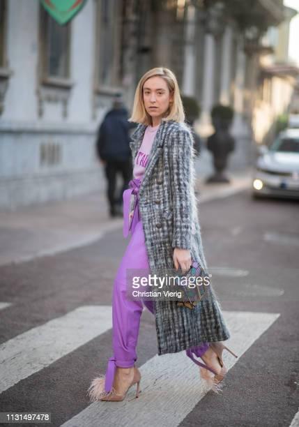 Sonia Lyson is seen wearing shoes Jimmy Choo pink pants Attico Alberta Ferretti jumper Boyy bag coat giadabenincasa on Day 3 Milan Fashion Week...