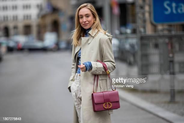 Sonia Lyson is seen wearing sneaker New Balance, Dior bag in bordeaux, ba&sh pants, remain trench coat, batik top Tory Burch Sport, Dior neck on...