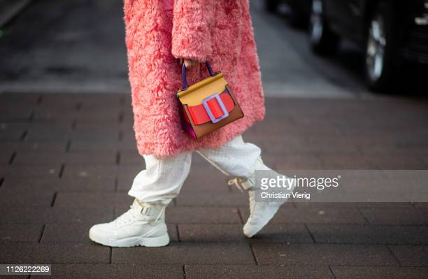 Sonia Lyson is seen wearing white Dior hightop sneakers, Sportmax coat, Boyy bag during the Copenhagen Fashion Week Autumn/Winter 2019 - Day 2 on...