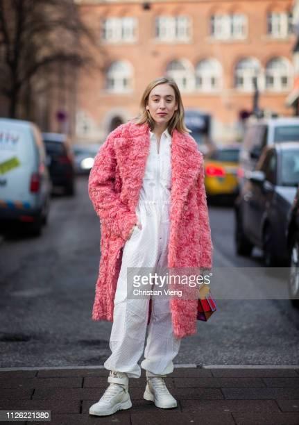 Sonia Lyson is seen wearing white Dior hightop sneakers white Lala Berlin jumpsuit Sportmax coat Boyy bag during the Copenhagen Fashion Week...