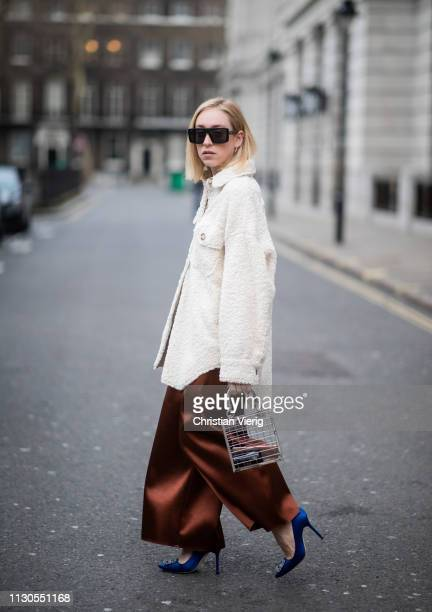 Sonia Lyson is seen wearing wide leg pants, shearling shirt Topshop, see through bag Topshop, Zara sunglasses during London Fashion Week February...