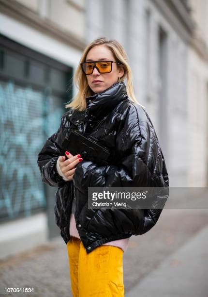 Sonia Lyson is seen wearing yellow velvet pants striped knit other stories black down feather jacket Pyrenex trekking boots Edited yellow sunglasses...