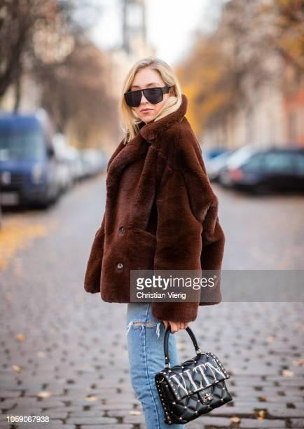 Sonia Lyson is seen wearing Zara pumps, ripped denim jeans Storets, Valentino bag, fake fur teddy jacket The Kooples, vintage sunglasses on November...