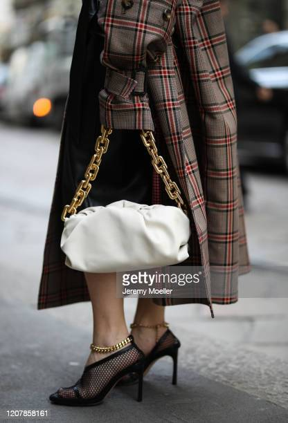 Sonia Lyson is seen wearing Zara skirt, Milk White shirt and Esau Tori coat during Milan Fashion Week Fall/Winter 2020-2021 on February 20, 2020 in...