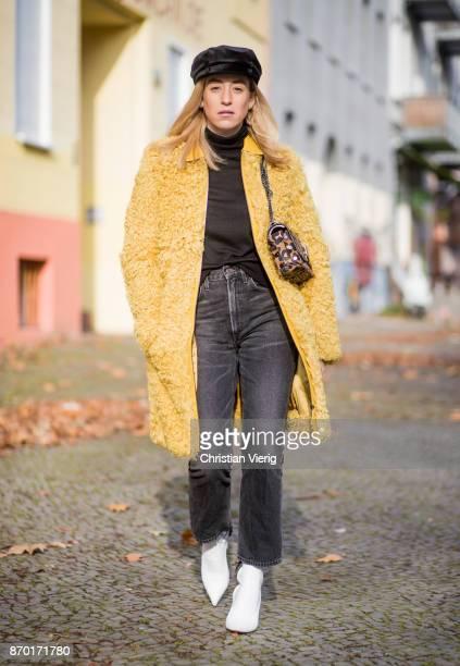 Sonia Lyson Jimmy Choo lockett petite bag hazelnut mix with leopard pony mix, shearling mustard coat Longchamp, black turtleneck & black Zara hat,...