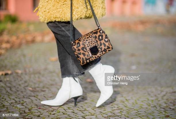 Sonia Lyson Jimmy Choo lockett petite bag hazelnut mix with leopard pony mix shearling mustard coat Longchamp black turtleneck black Zara hat dark...