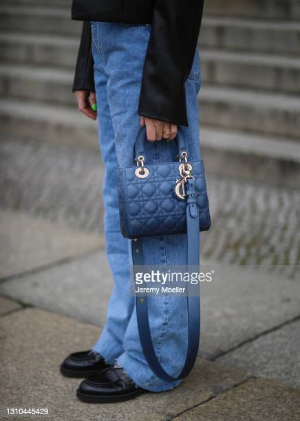 Sonia Lyson poses wearing Pull & Bear blue jeans, black Zara blazer, black Prada loafers and Lady Dior bag on March 29, 2021 in Berlin, Germany.